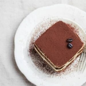 This delicious tiramisu recipe has quite a twist! Instead of layers of cream and ladyfingers there's a moist and fluffy vanilla cake soaked with a spiked espresso mixture and topped with a heavenly mascarpone whipped cream frosting. this dessert is very appreciated by all the family, is a quite light, easy and a little different from the original.